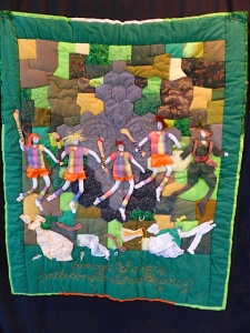 Quilt: 'Camogie Players with Constance Markievicw' by Eileen Haley