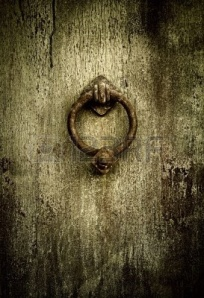 4880615-grunge-medieval-background--rusty-antique-door-knocker