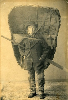 Fisherman carrying a coracle