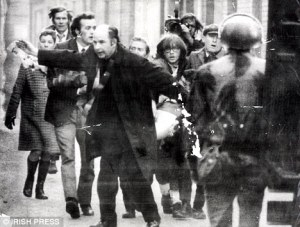 Bishop Daly helping victims of Bloody Sunday. Daily Mail