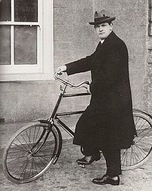 michael_collins_on_bicycle